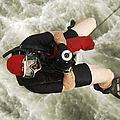 A Diver Is Hoisted Aboard An Sh-60f by Stocktrek Images