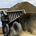 A Dump Truck Carrying Gravel Kicks by Raymond Gehman