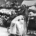 A Family And Their Push Cart by Underwood Archives