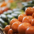 A Farm Stand Display Of Fresh Produce Tomatoes And Cucumbers by Mint Images - Tim Pannell