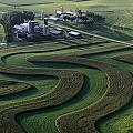 A Farm With Curved And Twisting Fields by Paul Chesley