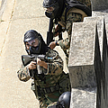 A Fire Team Returns Fire From A Balcony by Stocktrek Images