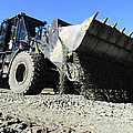 A Front End Loader Raising A Road Bed by Stocktrek Images