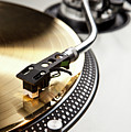 A Gold Record On A Turntable by Caspar Benson