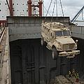 A Harbor Crane Lifts A Mine-resistant by Stocktrek Images
