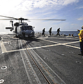 A Helicpter Sits On The Flight Deck by Stocktrek Images