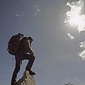 A Hiker Rests Atop A Huge Granite by Gordon Wiltsie
