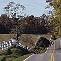 A Hilly Country Road Passes A Fenced by Medford Taylor