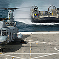 A Hovercraft Approaches Uss New Orleans by Stocktrek Images