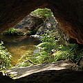 A Huge Hole In Rock With A Water View by Jennifer Holcombe