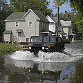 A Humvee Drives Through The Floodwaters by Stocktrek Images