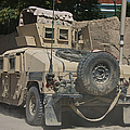 A Humvee Patrols The Streets Of Kunduz by Terry Moore