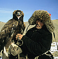 A Kazakh Eagle Hunter Poses by Ed George