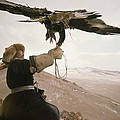 A Kazakh Hunter Strains To Support by David Edwards