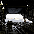 A Loadmaster Guides The Pilot Of A C-17 by Terry Moore