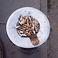 A Lot Of Cigarettes Stubbed Out At A Garbage Bin by Ashish Agarwal