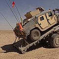 A M1114 Armored Vehicle Is Unloaded by Stocktrek Images