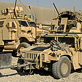 A M1114 Humvee Sits Parked In Front by Stocktrek Images