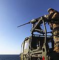 A Machine Gunner Mounts A M-2 by Stocktrek Images