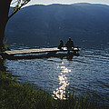 A Man And His Dog On A Lake Skaha Dock by Mark Cosslett