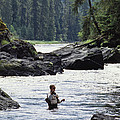 A Man Fishes For Cutthroat Trout In An by Bill Curtsinger