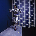 A Man Walks A Wall In A Special Harness by Nasa