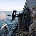 A Marine Fires A .50-caliber Machine by Stocktrek Images