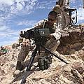 A Marine Sets Up A Laser Designator by Stocktrek Images