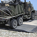 A Medium Tactical Vehicle Replenishment by Stocktrek Images