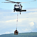 A Mh-60 Knighthawk Carries Supplies by Stocktrek Images