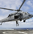 A Naval Aircrewman Is Hoisted Into An by Stocktrek Images