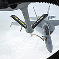 A Navy Fa-18f Super Hornet Is Refueled by Stocktrek Images