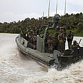A Navy Riverine Patrol Boat Conducts by Stocktrek Images