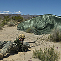 A Paratrooper Recovers After Landing by Stocktrek Images