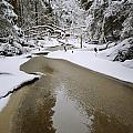 A Partially Frozen Stream Runs by Mattias Klum