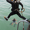 A Photographer Documents A Navy Diver by Stocktrek Images