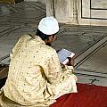 A Pious Devotee Reading The Quran Inside The Jama Masjid In Delhi by Ashish Agarwal