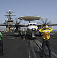 A Plane Director Guides An E-2c Hawkeye by Stocktrek Images