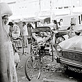 A Rickshaw Driver Sleeping In Jaipur In India by Shaun Higson