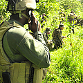A Riverine Soldier Radios In Mock by Stocktrek Images