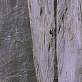 A Rock Climber Clings To An Overhang by Gordon Wiltsie