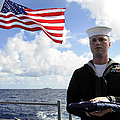 A Sailor Carries The National Ensign by Stocktrek Images