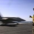 A Sailor Ensures An Fa-18c Hornet by Stocktrek Images