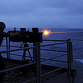 A Sailor Fires A .50-caliber Machine by Stocktrek Images