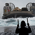 A Sailor Guides A Landing Craft Air by Stocktrek Images