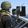 A Sailor Manning A .50-caliber Machine by Stocktrek Images