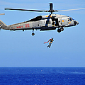 A Search And Rescue Swimmer Is Lowered by Stocktrek Images