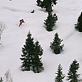A Skier Makes His Way Down A Hill by Gordon Wiltsie