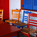 Colorful Table And Chairs Greece by Bob Christopher