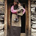 A Smiling Bhutanese Woman And Child by Paul Chesley